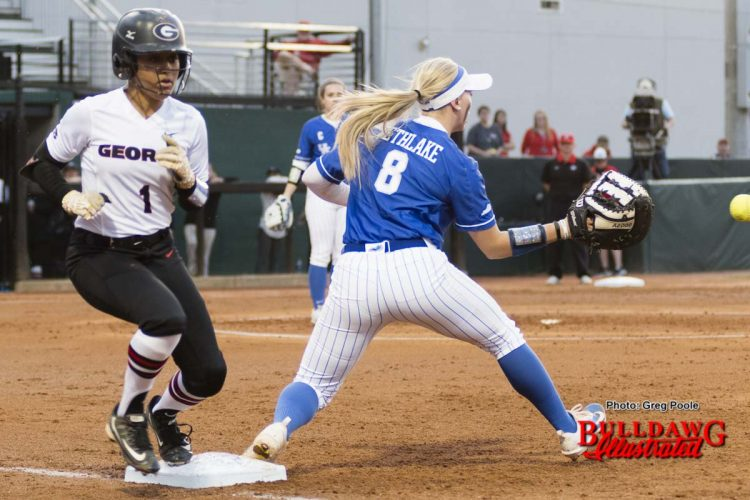 Cortni Emanuel beats the throw to first base