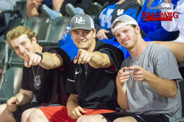 Baseball players Mason Meadows, Tony Locey and Drew Moody take in the Lady Diamond Dawgs' game