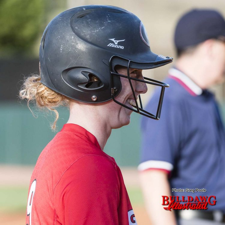 Allysen Febrey smiles at the 3rd base coach after driving in 2 runs