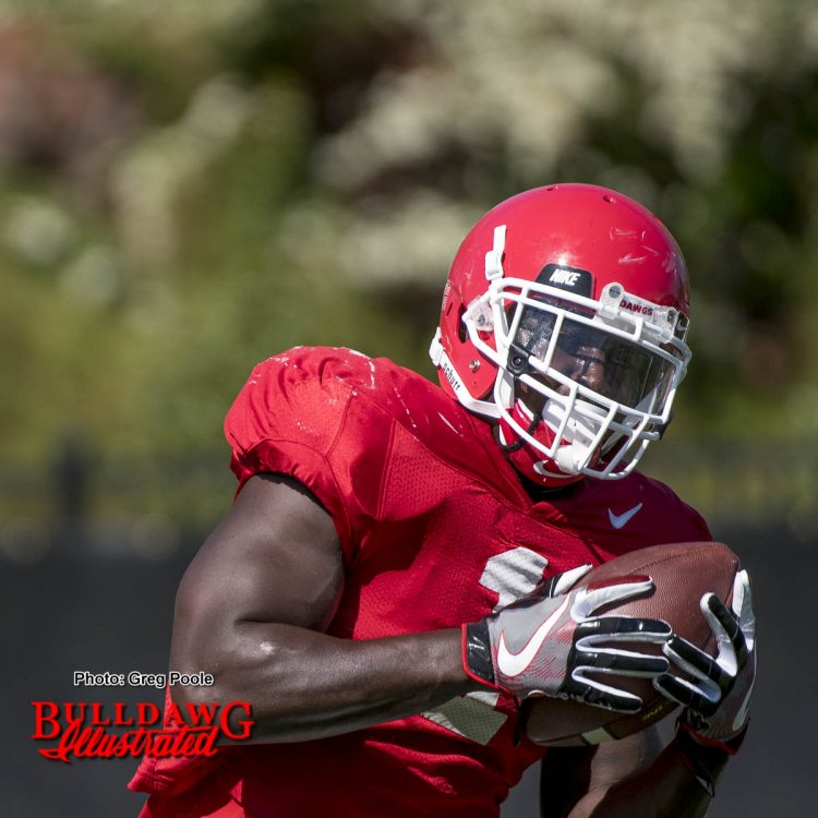 Sony Michel catches a ball during a drill.
