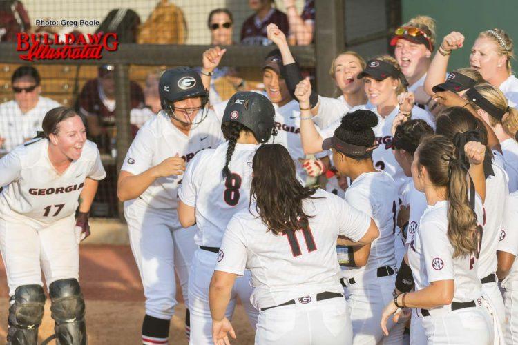 Celebration at home plate for Alyssa DiCarlo's home run