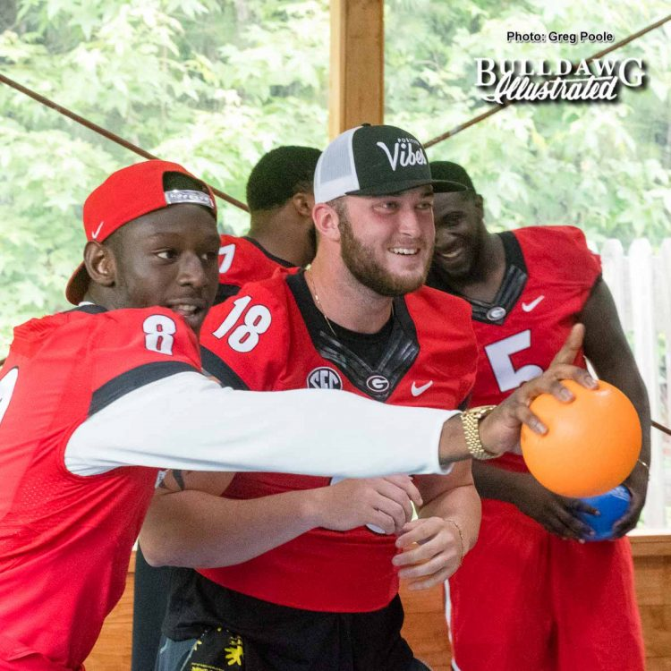 Riley Ridley (8) and Isaac Nauta (18) plot strategy during the dodgeball match a Camp Sunshine June 21, 2017