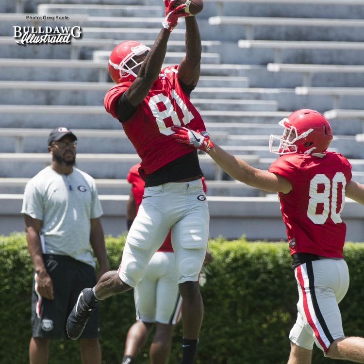 Freshman WR Mark Webb Jr. (81) climbs the ladder to make the catch over WR J.T. Dooley (80) - Georgia's 1st scrimmage of Fall Camp - Saturday, August 12, 2017