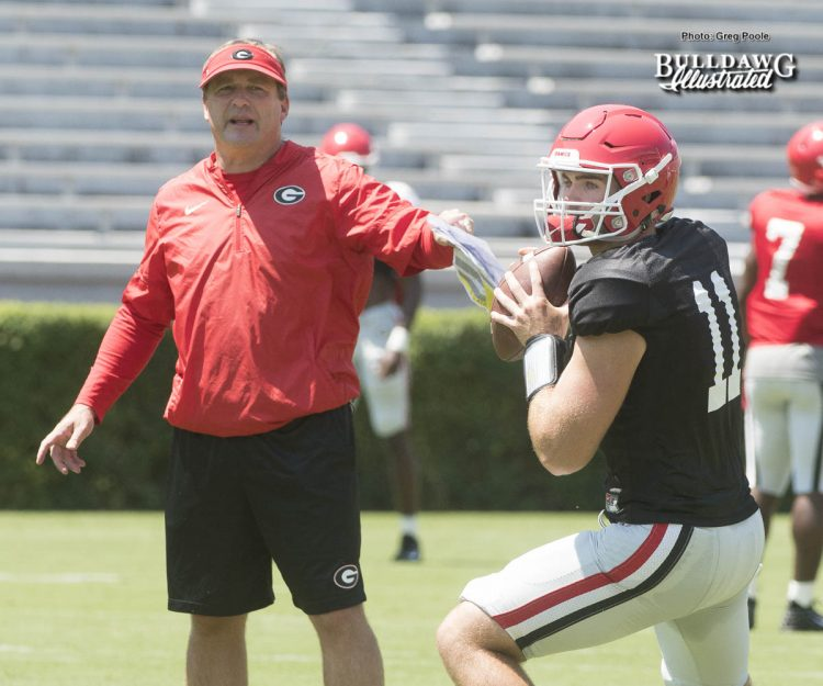 Kirby Smart looks on as his freshman QB Jake Fromm (11) goes through drills during UGA's second scrimmage of Fall Camp - Saturday, August 19, 2017 -