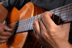 Playing-acoustic-guitar-lg_listing