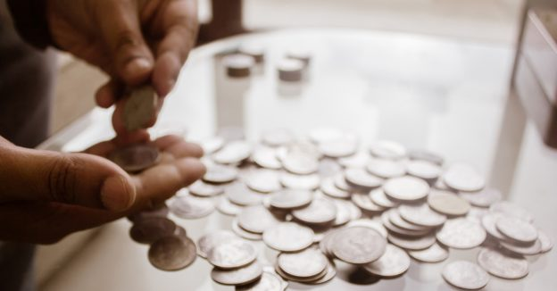 man counting coins