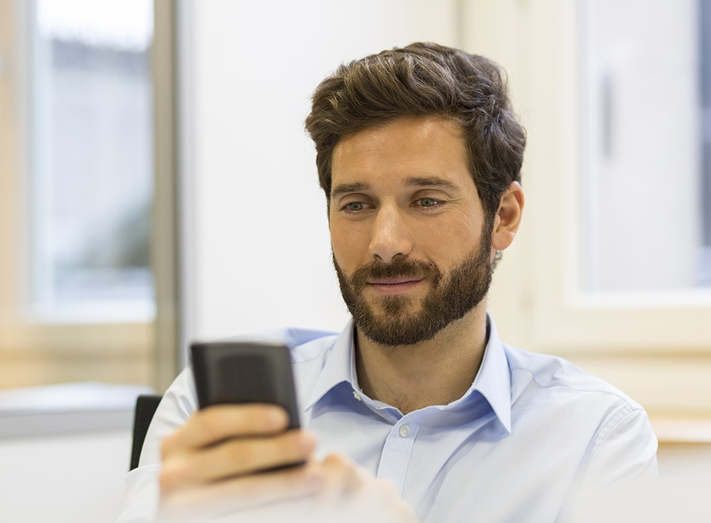 man using a cell phone
