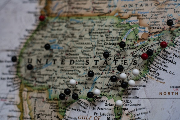 A map with pins in different parts of the US