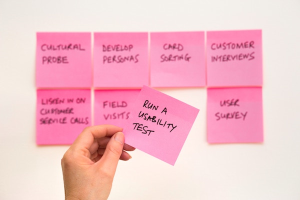 Pink Post-It notes listing different approaches to market research