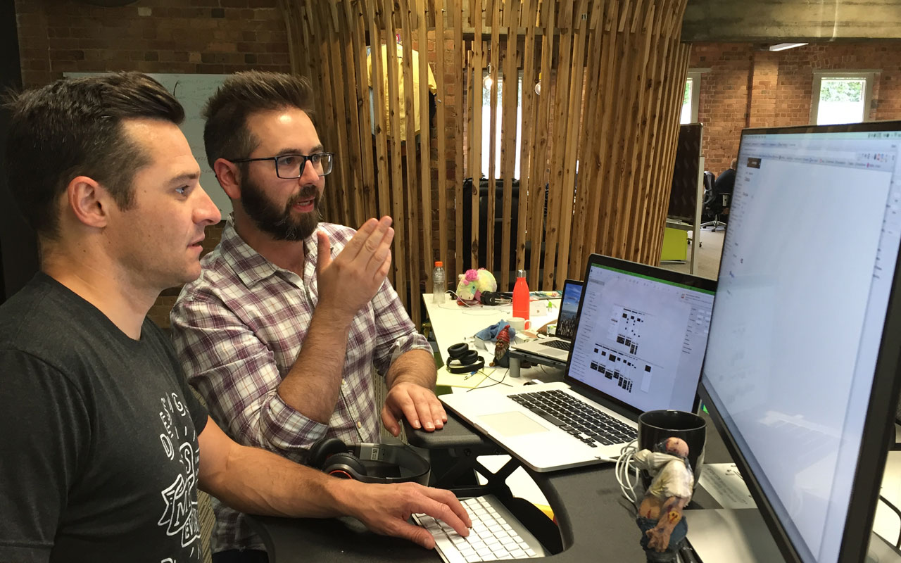 UX and UI designers collaborating at Envato.