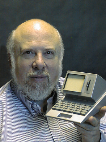 Jef Raskin holding a model of the Canon Cat computer. Photo from Wikipedia. Creative Commons Attribution 2.0.