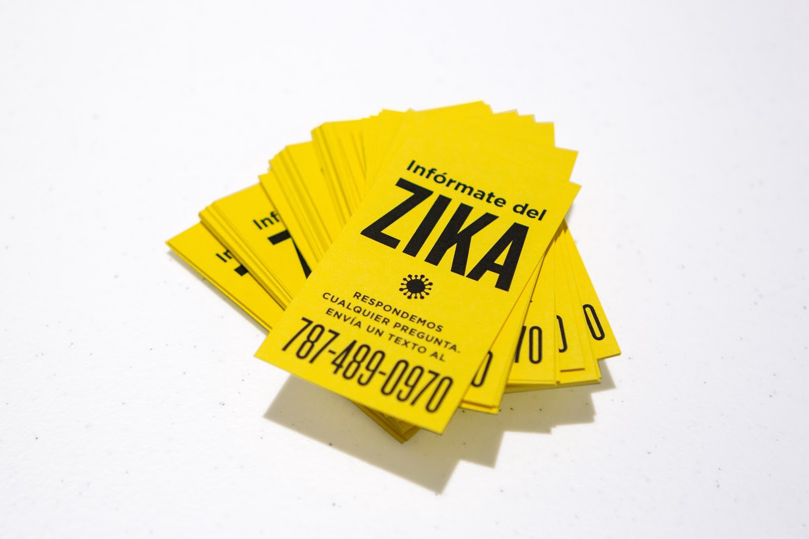 The cards that were distributed to create awareness around the Zikabot initiative.
