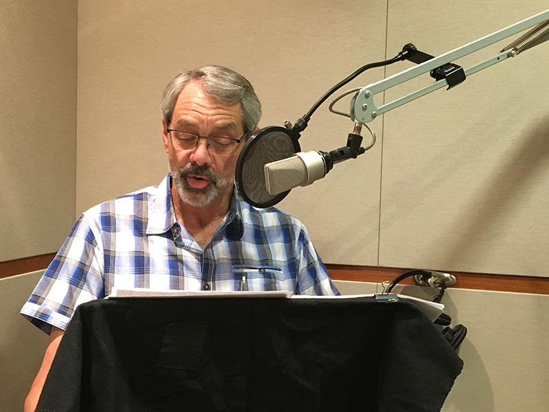Dave Evans recording the audiobook version of Designing Your Life.