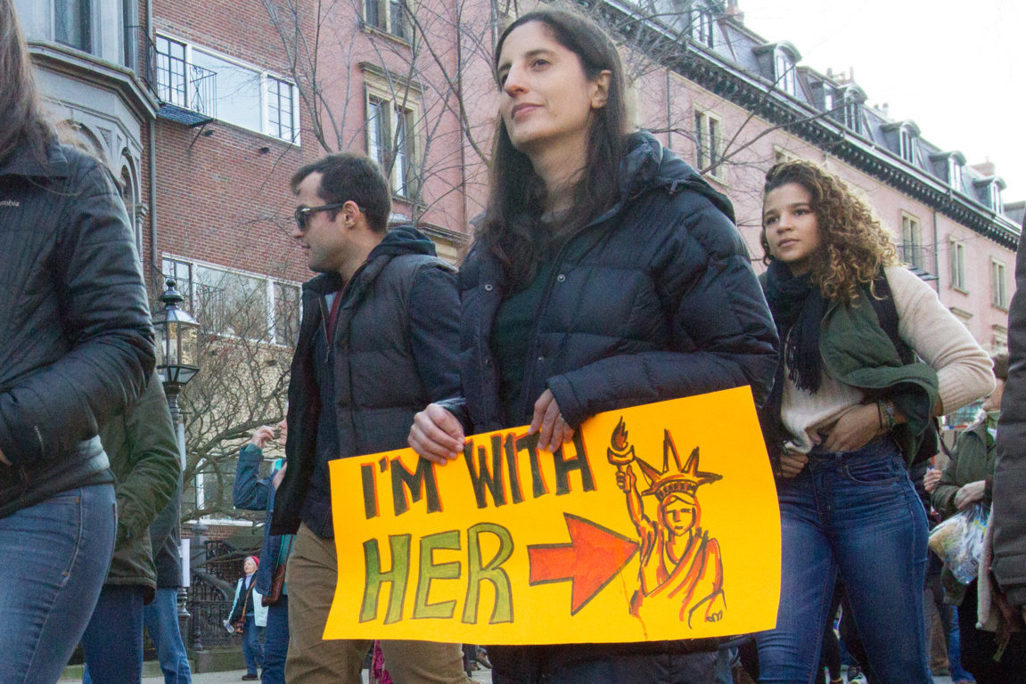 sign reading: I'm with her (statue of liberty)