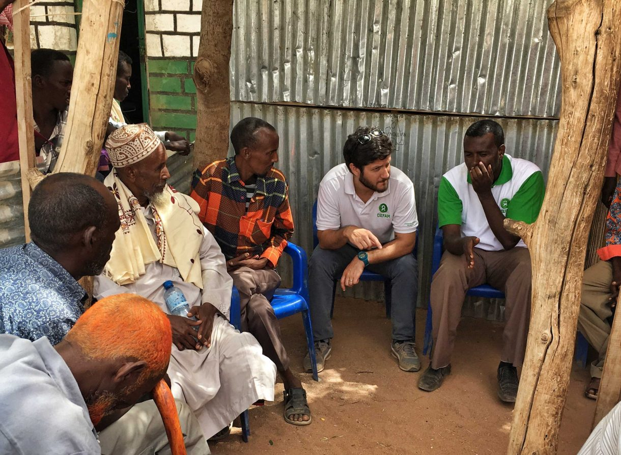 Nahuel Arenas (center) meets with members of a community in the Sanaag region in eastern Somaliland. Photo courtesy of Oxfam's partner organization Havayoco.