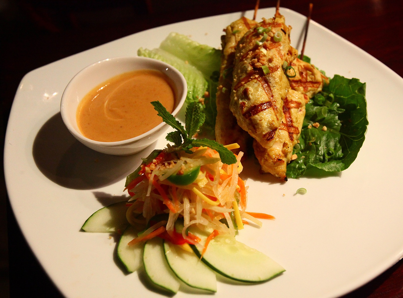 Saigon Bangkok's chicken satay with mango salad on Niagara Falls Boulevard in the Town of Tonawanda. (Robert Kirkham/Buffalo News)