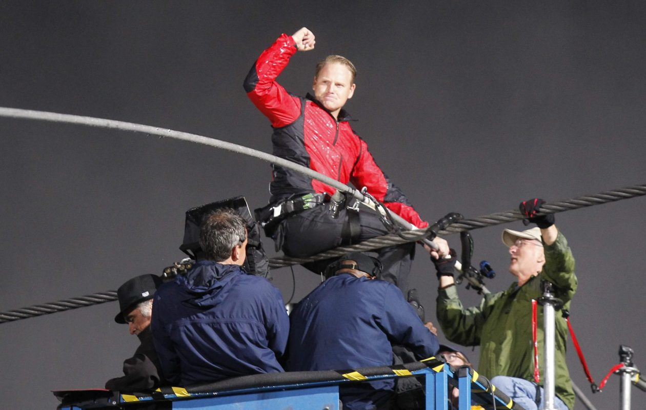 Nik Wallenda celebrates at the end of his successful walk from the U.S. to Canada across the Horseshoe Falls on a high wire on Friday, June 15, 2012. (Harry Scull Jr./Buffalo News)