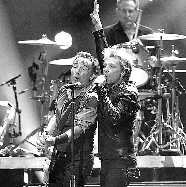 "NEW YORK, NY – DECEMBER 12:  Bruce Springsteen and Jon Bon Jovi perform during ""12-12-12"" a concert benefiting The Robin Hood Relief Fund to aid the victims of Hurricane Sandy presented by Clear Channel Media & Entertainment, The Madison Square Garden Company and The Weinstein Company at Madison Square Garden on December 12, 2012 in New York City.  (Photo by Larry Busacca/Getty Images for Clear Channel)"