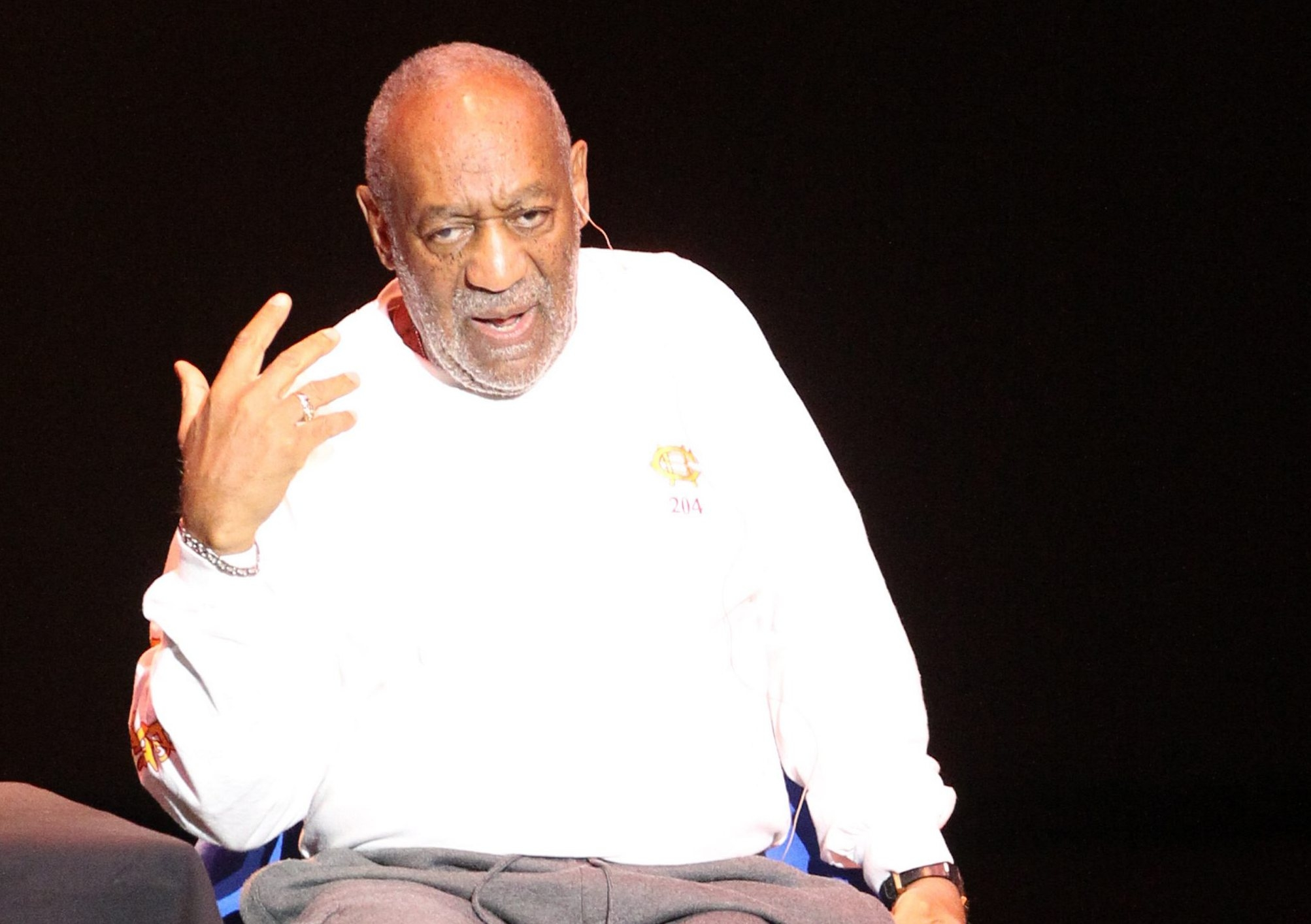 Bill Cosby sits in a chair at center stage and tells funny stories while performing Friday night in  Kleinhans Music Hall.