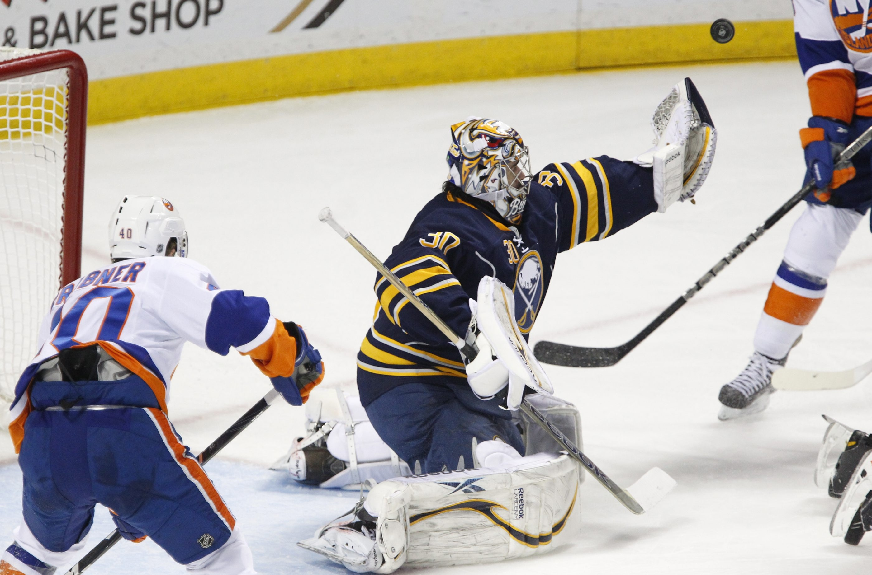 Sabres goalie Ryan Miller makes a save on a New York Islanders player during second-period action at the First Niagara Center.