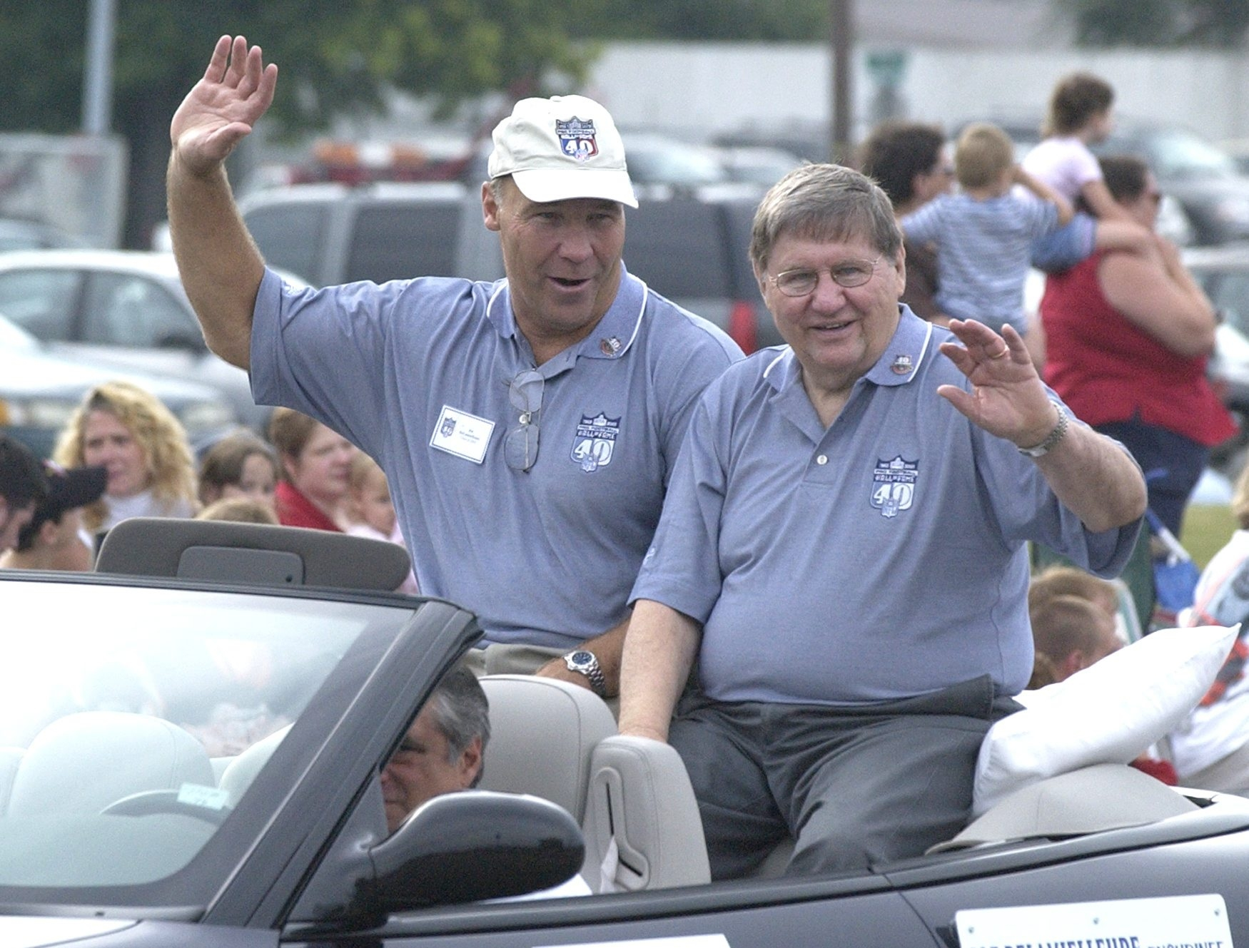 Joe DeLamielleure, left, a member of the Pro Football Hall of Fame's 2003 class, and presenter Larry Felser ride along the Hoover Grand Parade route in Canton, Ohio. Felser covered the Bills from the AFL's inception to retirement.