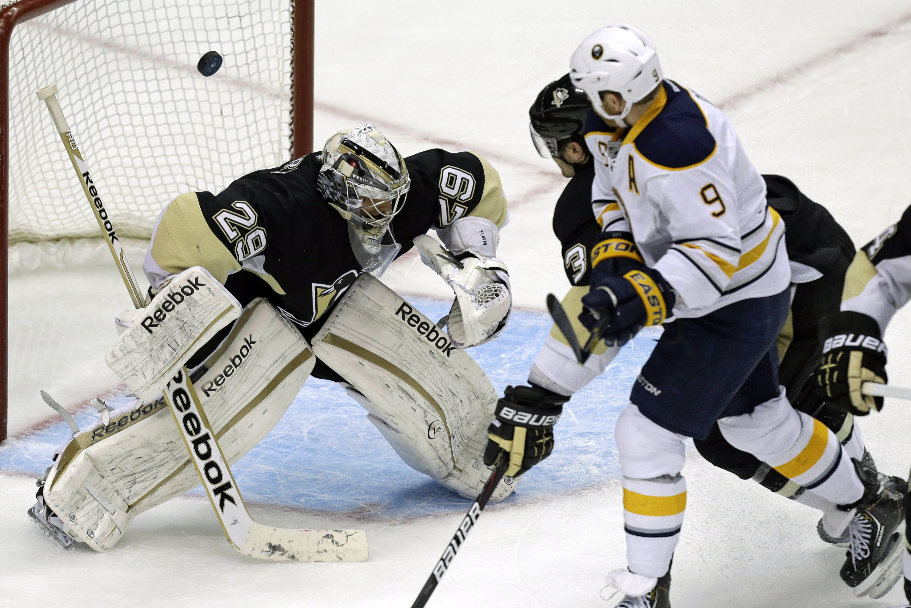 Buffalo's Steve Ott (9) deflects a rebound for a goal against Pittsburgh Penguins goalie Marc-Andre Fleury in the third period.