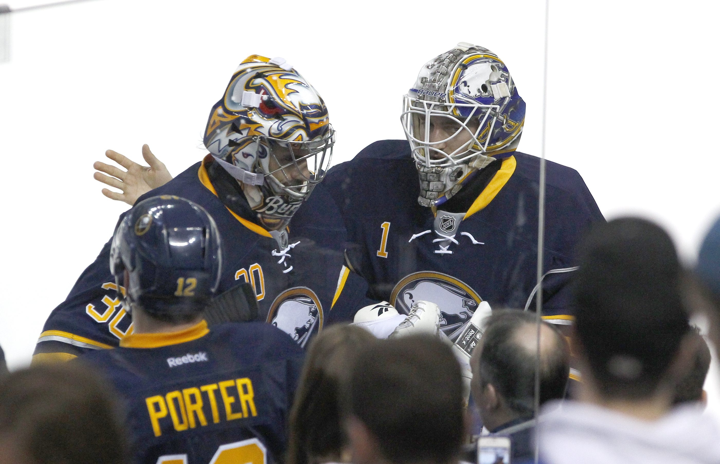 Sabres goaltender Ryan Miller, left, is patted on the back by Jhonas Enroth after Miller was pulled in the second period against the Rangers on Friday.