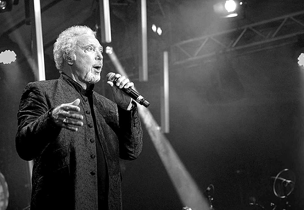 LONDON, ENGLAND - SEPTEMBER 27: Tom Jones performs at Senate House as part of the annual Arthur's Day celebrations on September 27, 2012 in London, England.  Arthur's Day sees fans come together to experience live music events in over 500 intimate venues around the island of Ireland and for the first time in Great Britain, including surprise performances in small pubs. Leading the celebrations in London are Sir Tom Jones, Razorlight, Wretch 32 and VV Brown, whilst artists as diverse as Example, Tinie Tempah, Ellie Goulding, Mika, Professor Green, Fat Boy Slim, Texas, Fun Lovin' Criminals, Amy Macdonald, Primal Scream and Mumford and Sons perform in pubs around Ireland. The fourth annual celebration will take place in over 55 countries including, Spain, Italy, Germany, France, Caribbean nations, Malaysia, Indonesia, Australia, Japan, Singapore, South Korea, Ireland and Great Britain. (Photo by Ian Gavan/Getty Images for Guinness)