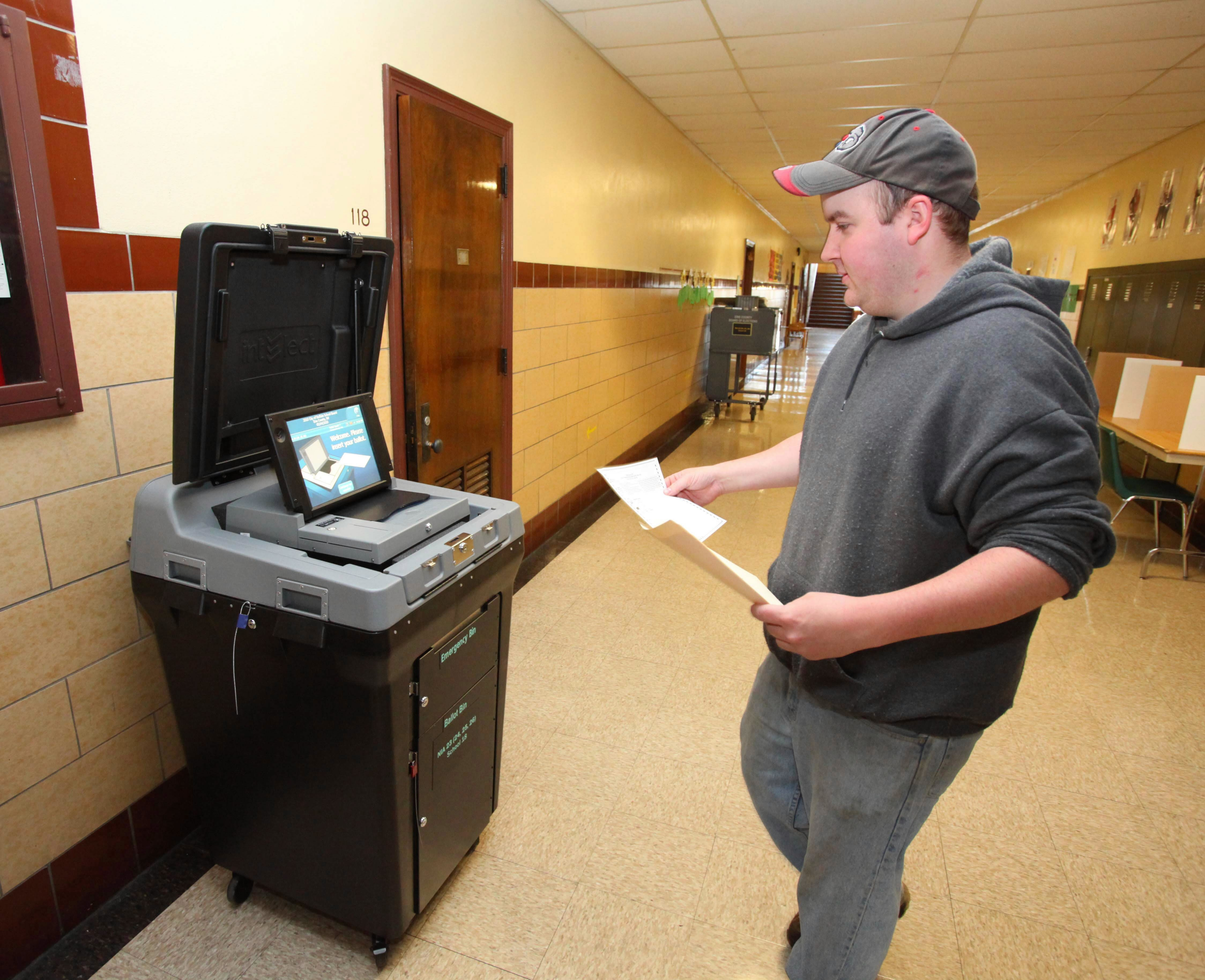 With three weeks left before the election for Buffalo School Board, some activities behind the scenes are raising questions about candidates' agendas. In this 2010 file photo, Rich Perry of Buffalo casts his vote in the Buffalo School Board election at School 18 on Hampshire Avenue. (Buffalo News file photo)