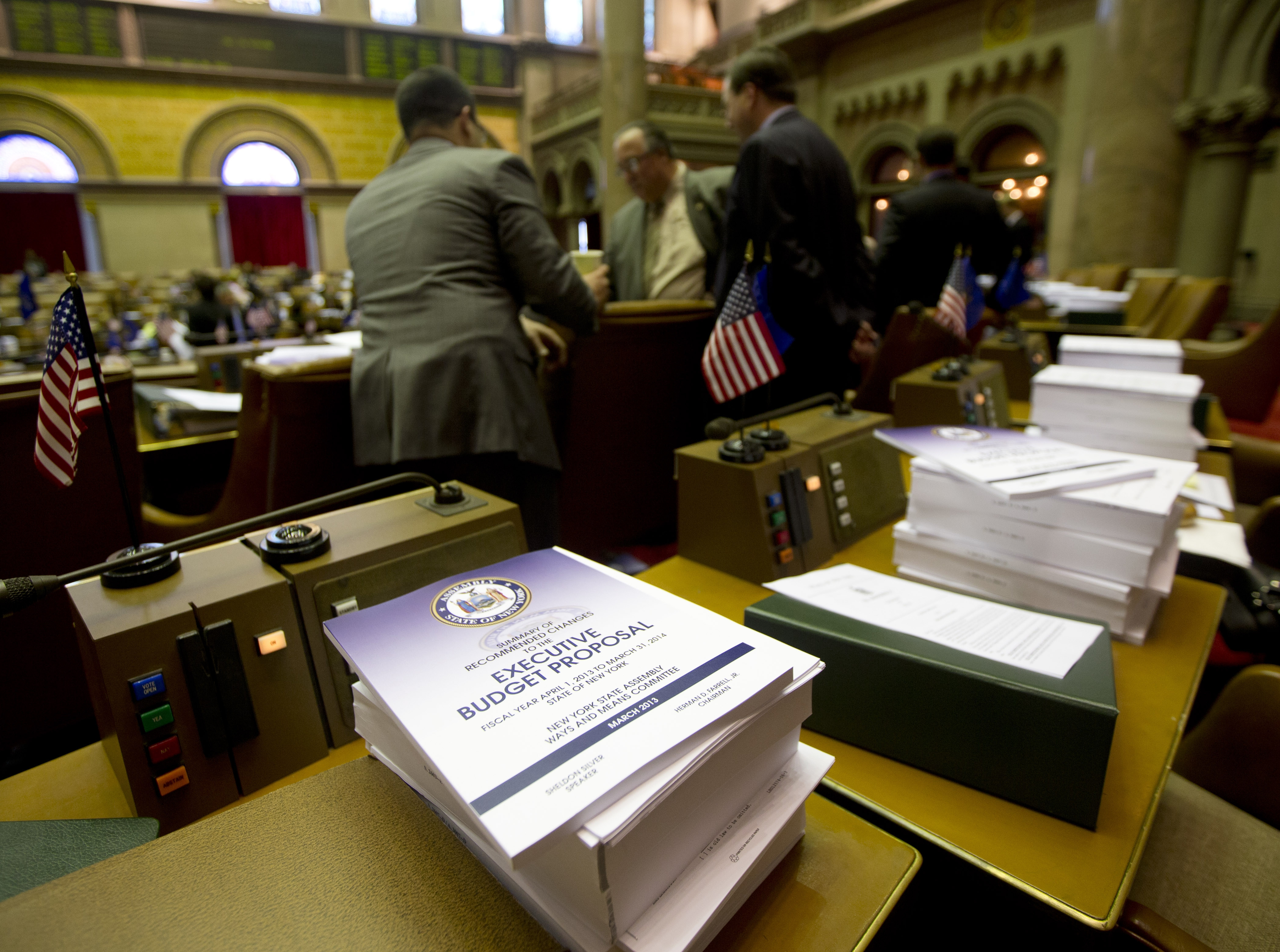 The State Legislature approved a budget on time for a third straight year that tapped money from some agencies including the State Insurance Fund to balance spending, including a tax credit.