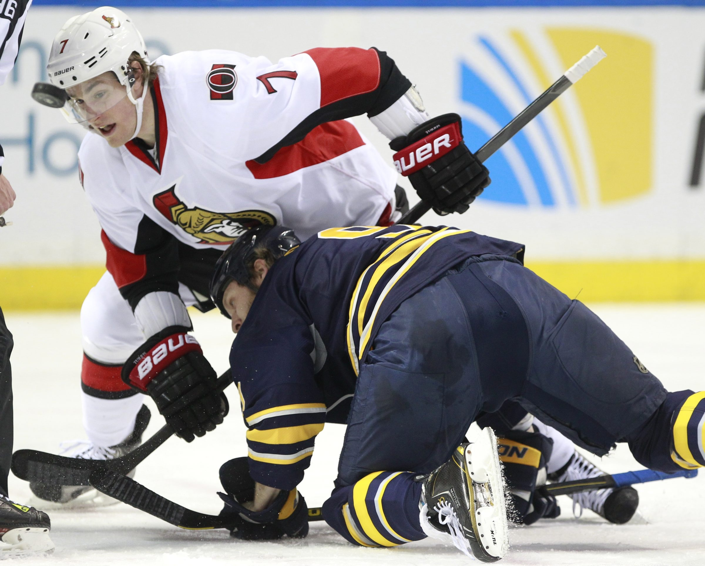 Buffalo's Steve Ott tangles with Ottawa's Kyle Turris (7) during a faceoff at the First Niagara Center.