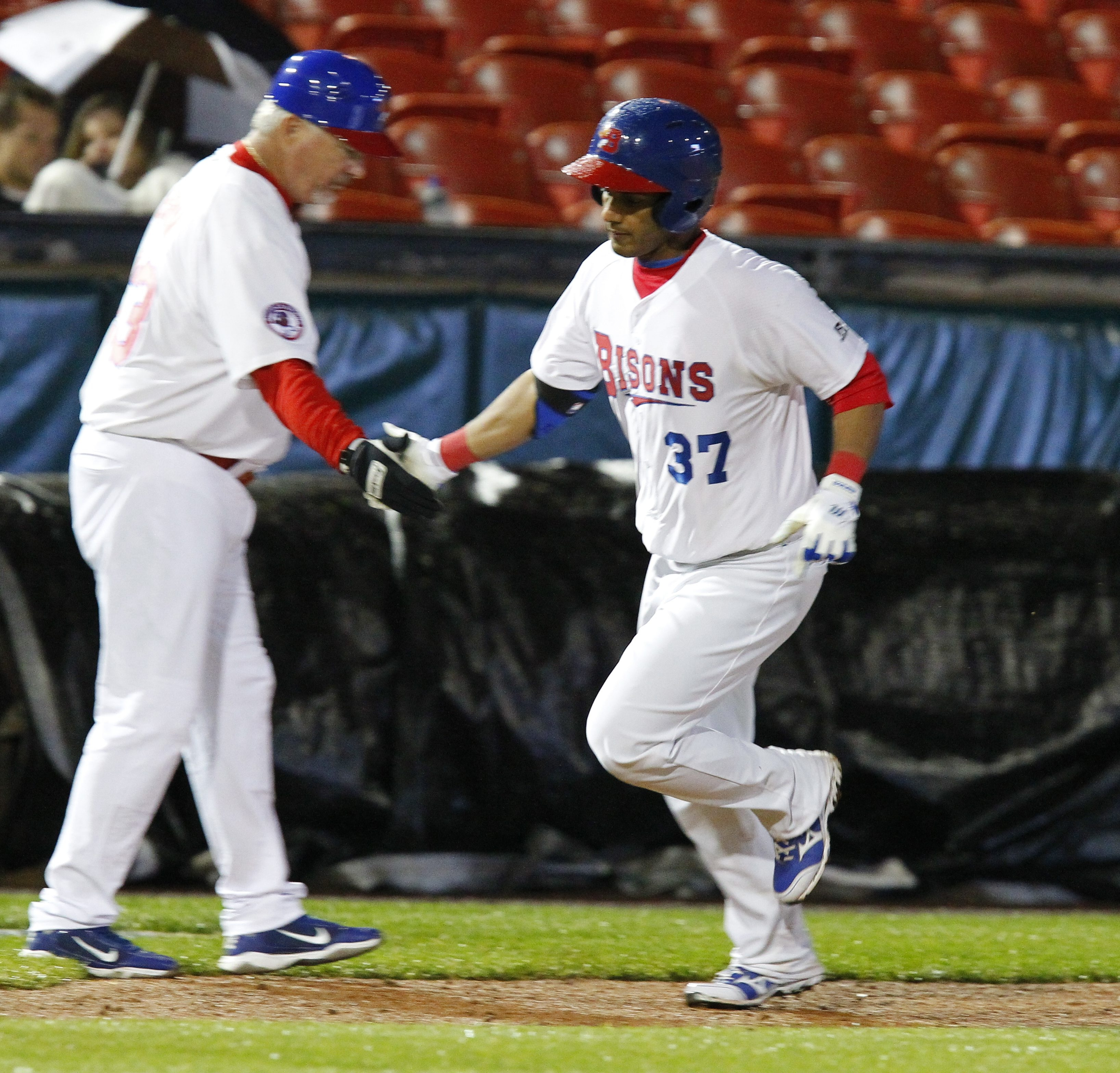 The Bisons' Ricardo Nanita (37) rounds third base and receives congratulations from manager Marty Brown after his solo home run in the fifth inning against Indianapolis.