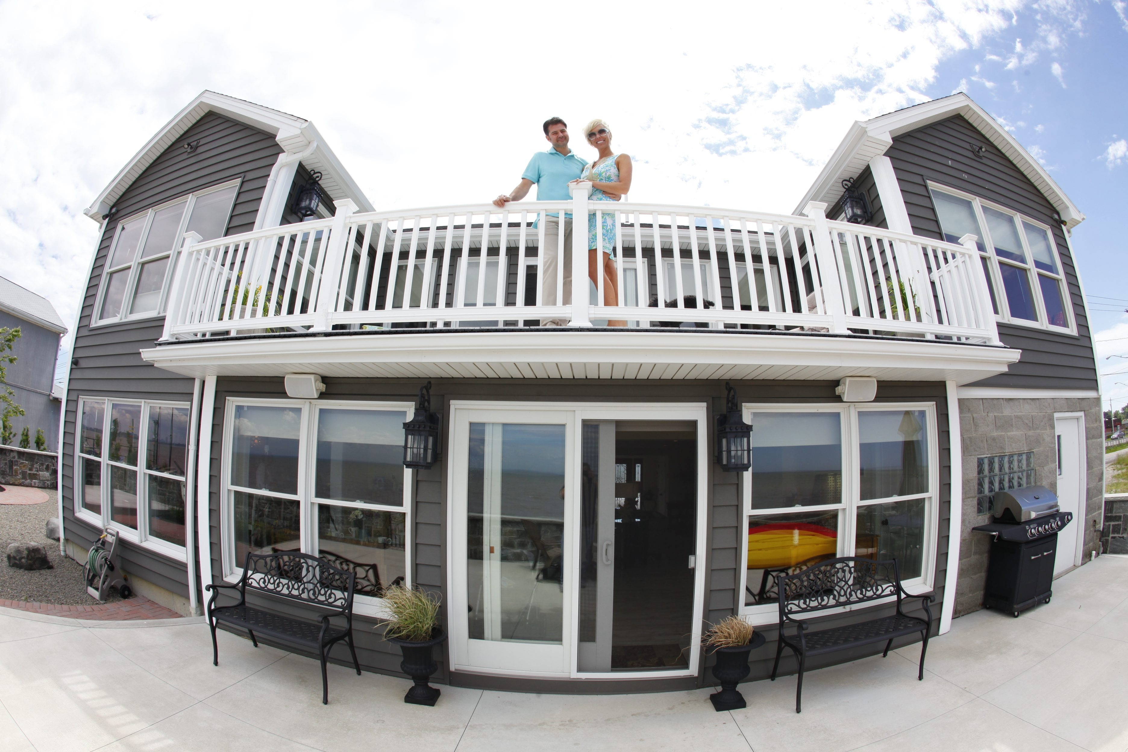 Through the fish-eye lens: Leanne and Chris Mattioli on the deck of their home on Lake Erie in Hamburg.