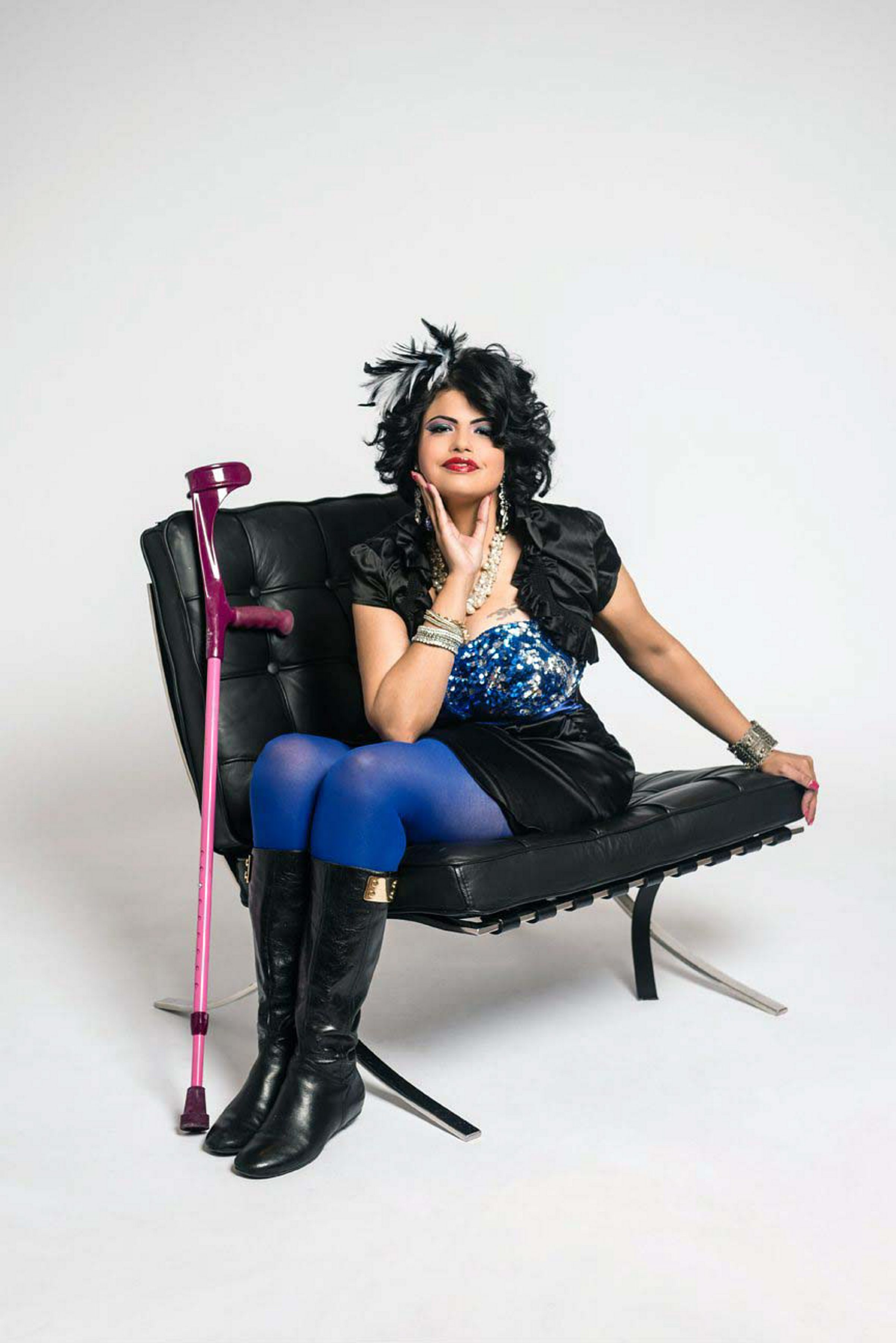 Jewel Kats wears her disability with pride – along with her feathers,  tattooed eye makeup s and hot-pink crutches.