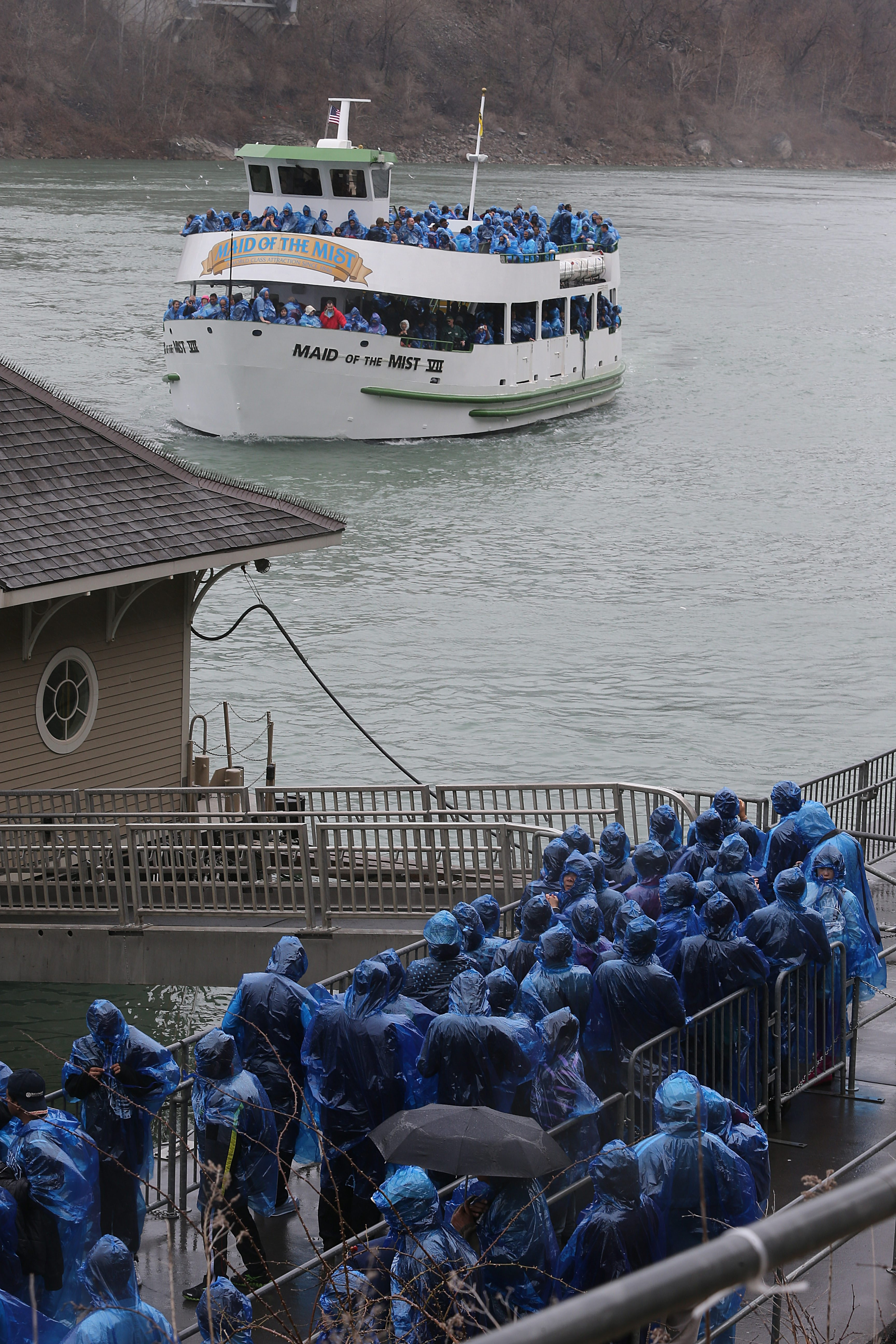 The Maid of the Mist VII returns to the dock after completing its first trip of the season at Niagara Falls State Park, as the next group of passengers waits to board, Friday, April 19, 2013.  The Maid of the Mist VII is the latest addition to the Maid fleet. (Charles Lewis/Buffalo News)