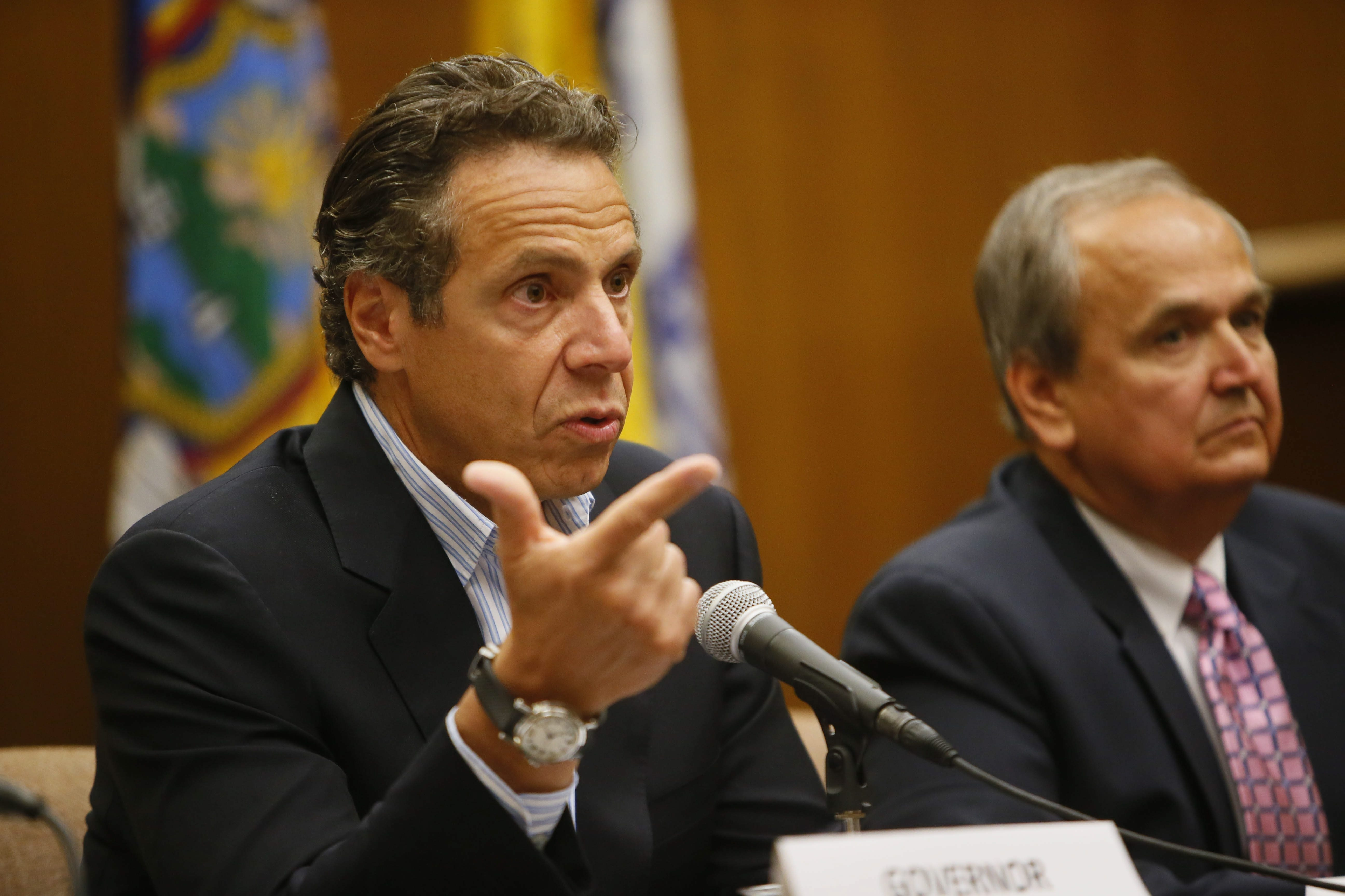 Gov. Andrew M. Cuomo, left, with State Sen. George Maziarz at Lockport City Hall, says he will pursue storm aid for Niagara Falls as he did for Lockport.