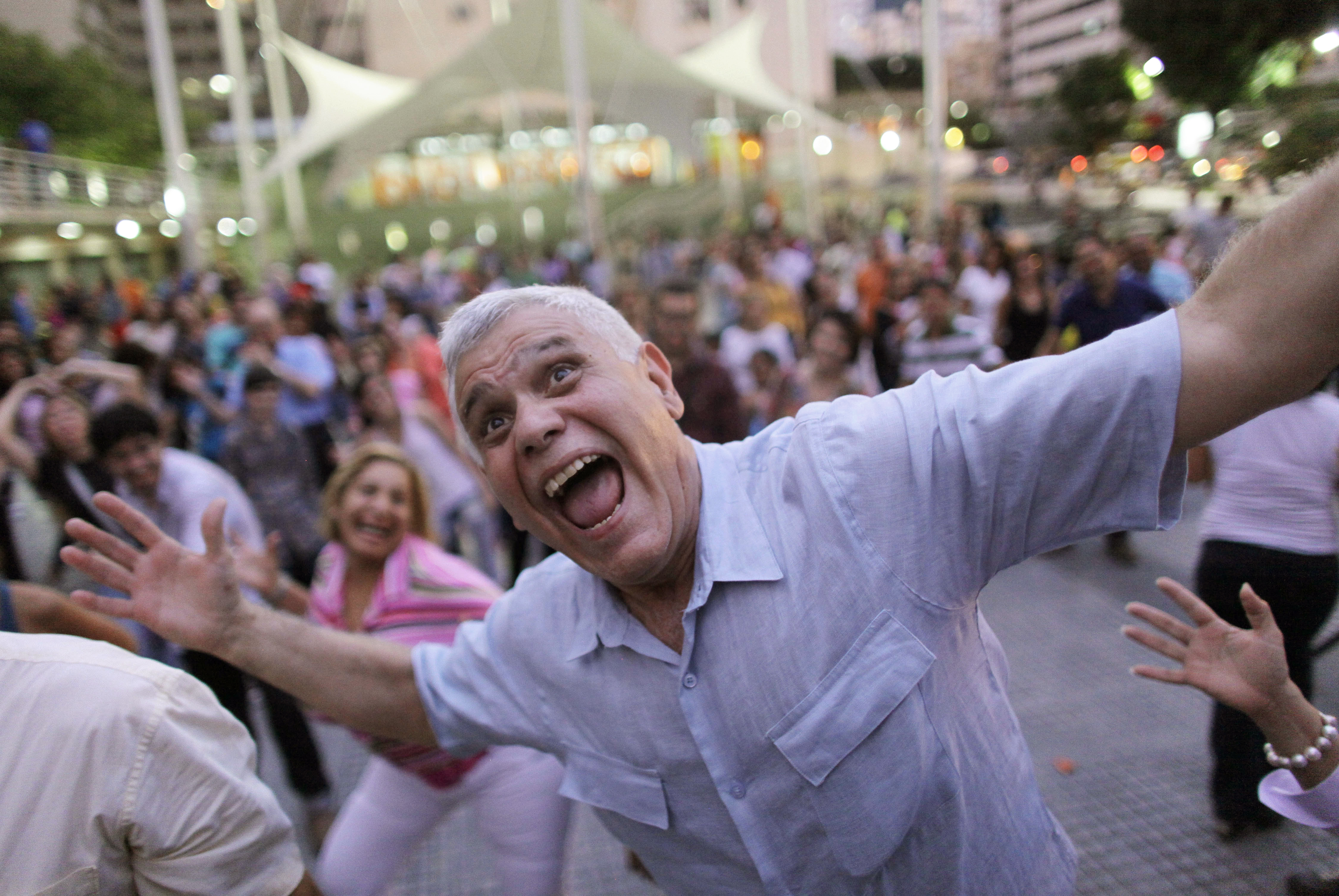 A man laughs during a session of laugher therapy in a public plaza in Caracas, Venezuela. Laughter is spreading as a pathway to good health, as experts say that it helps refresh the mind and body, eases stress and improves the lymphatic and circulatory systems.