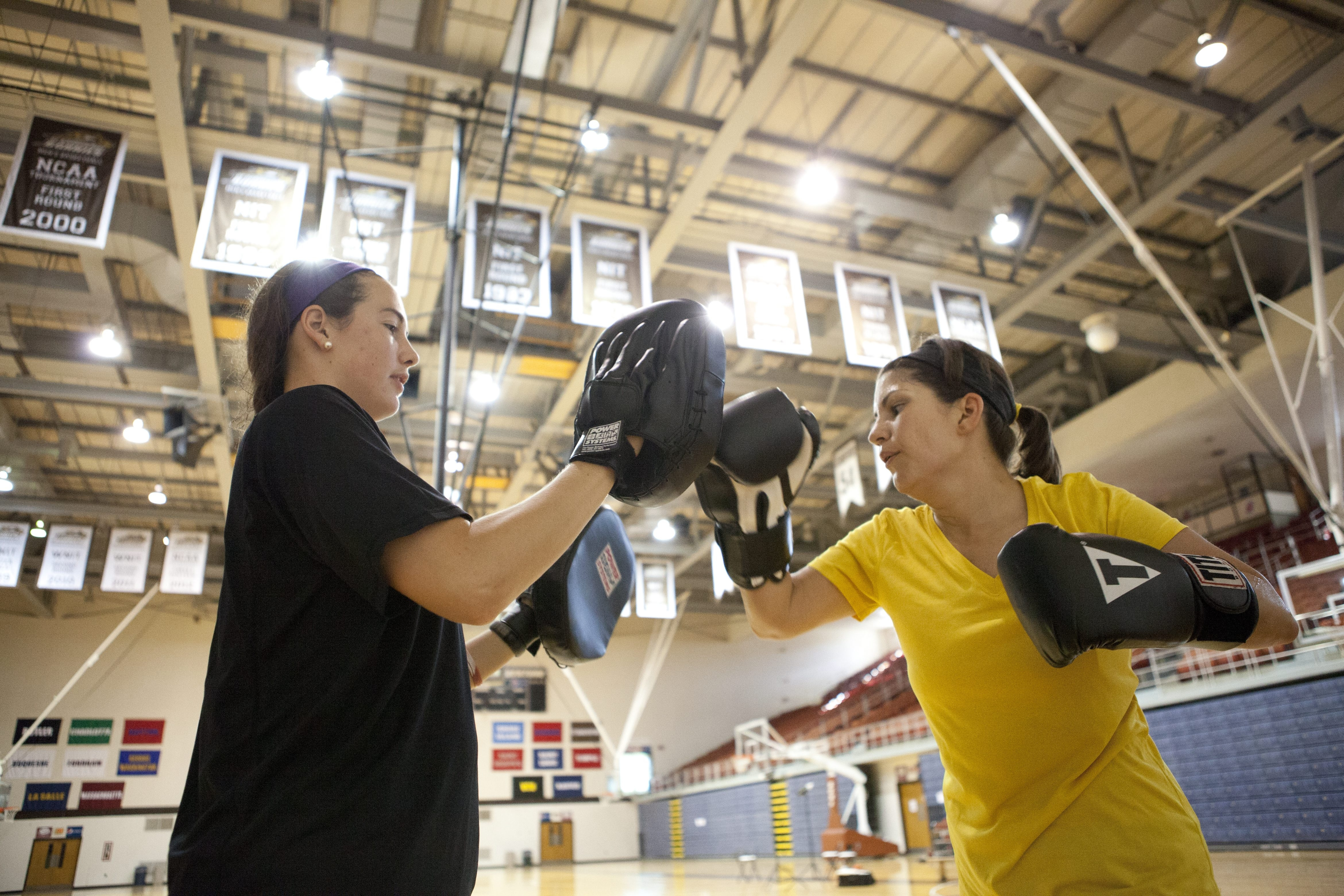 Amy Mortiz is put through a workout by Jessica Jenkins, a former Big 4 women's basketball standout who has started training would-be high-performance athletes.