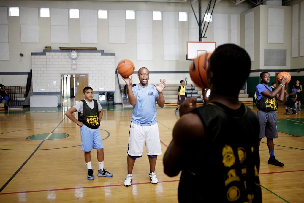 Don Marsh from NEBC Basketball Academy leads kids in basketball drills as a part of Game Changers, a year-old initiative that aims to reach out to at-risk youth at the Delavan-Grider Community Center.