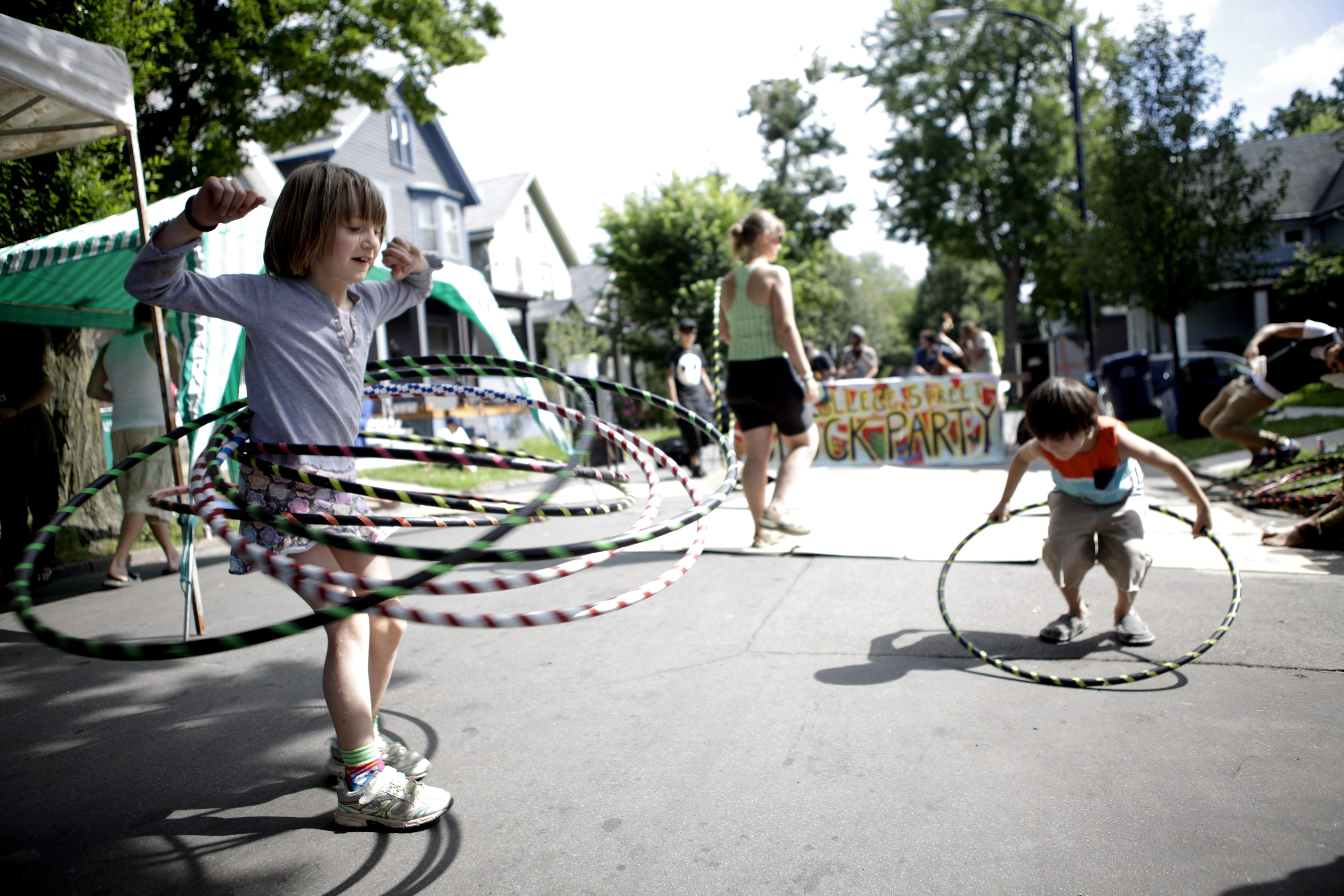 Elsi Omara spins seven hula hoops Sunday during the 11th annual College Street block party, as a part of the Buffalo Infringement Festival.