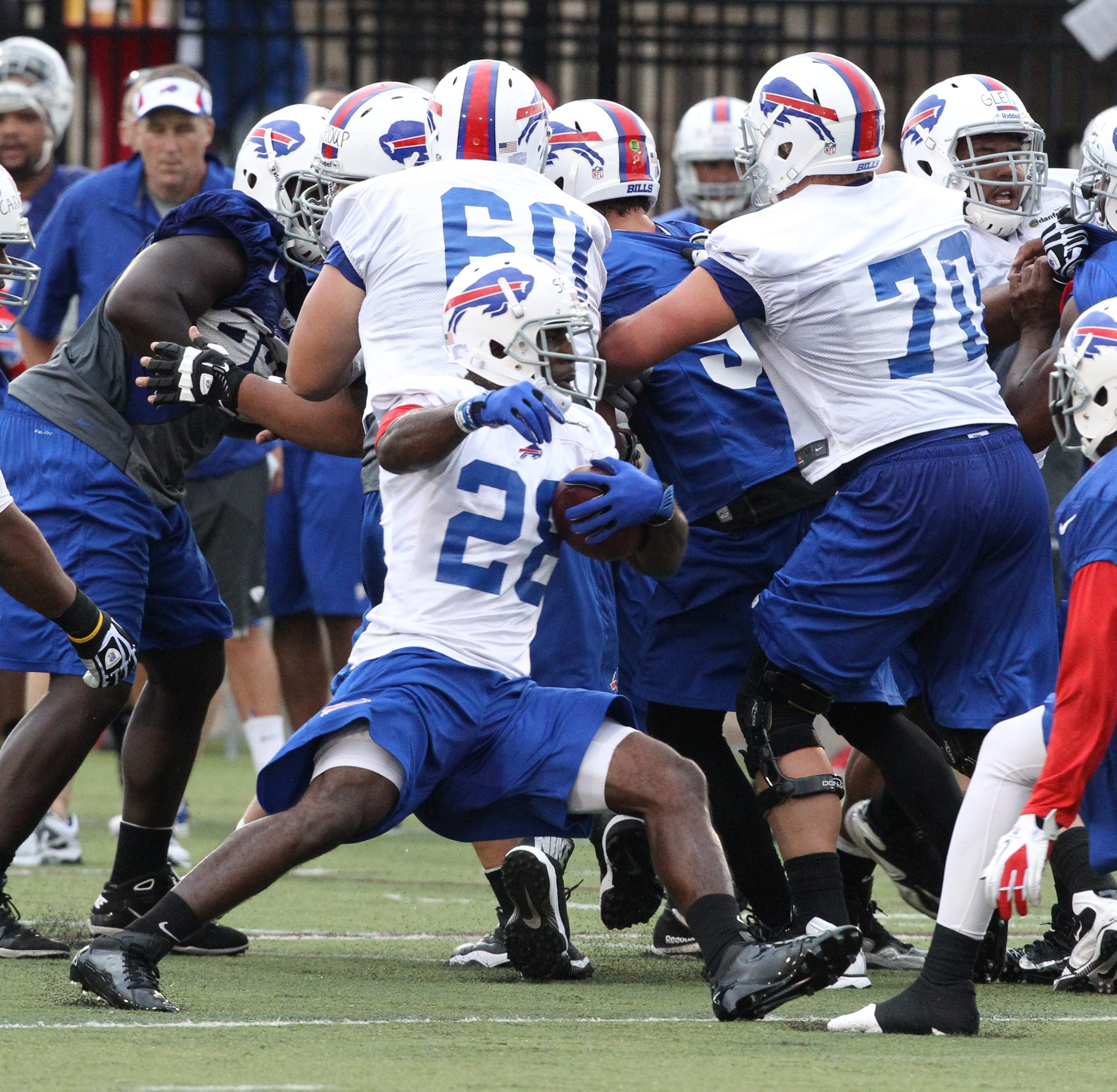 Bills running back C.J. Spiller makes a cut while running a pattern in a drill Sunday night at St. John Fisher College.