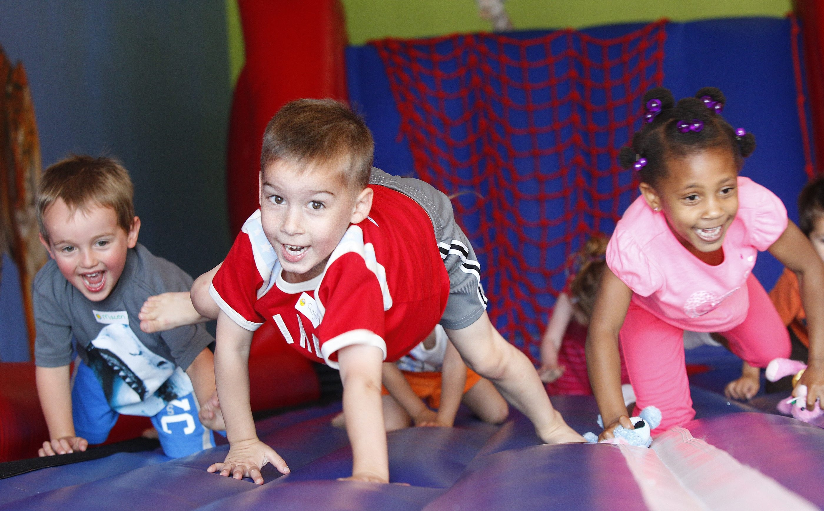 Roger Kaifas, crawls with other 3&4 year old during a fun fitness class for kids in a kids-only Fitness 360  room, on Wednesday, June 19, 2013.{Photo by Harry Scull Jr. / Buffalo News}