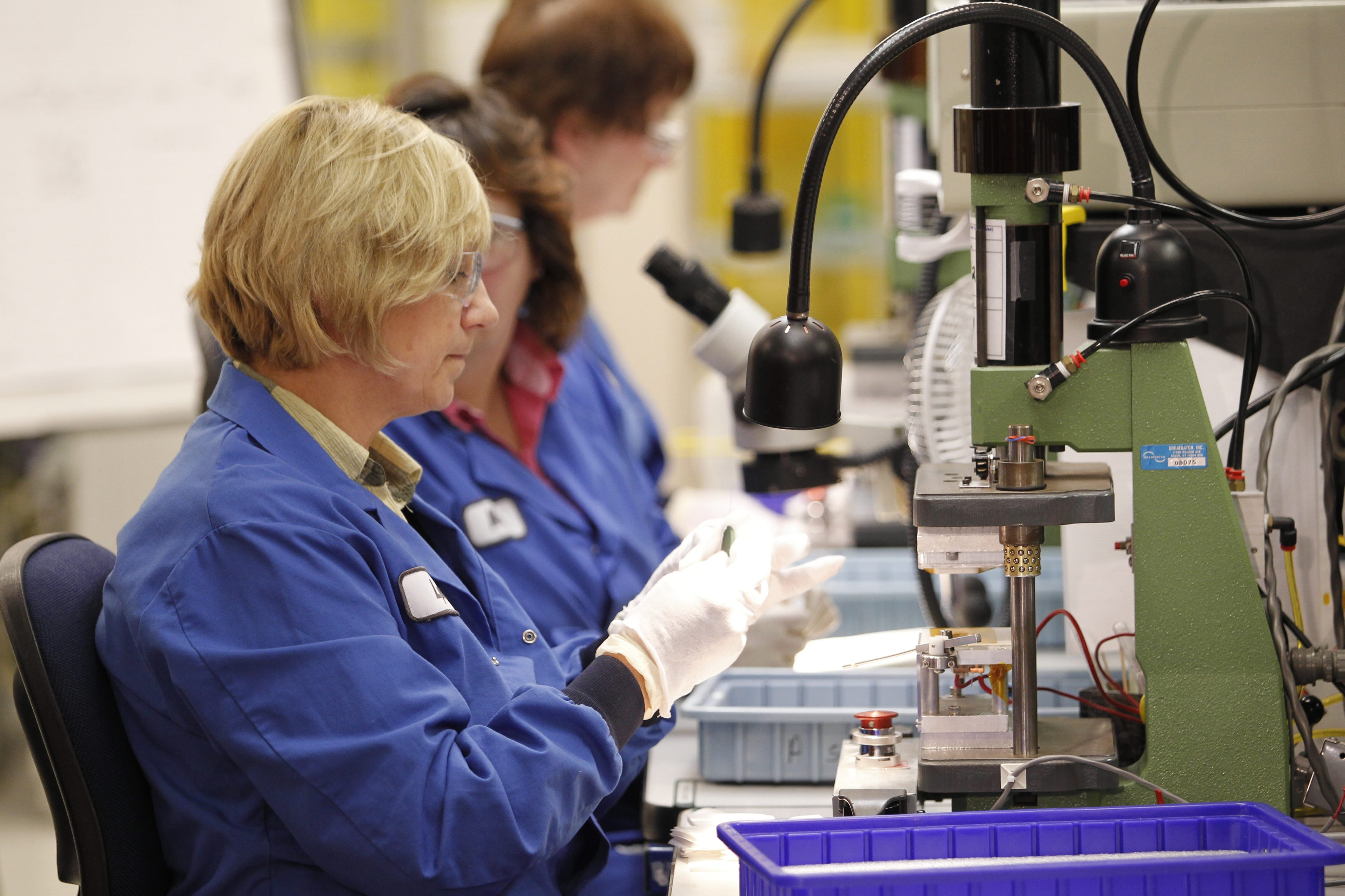 Employees working on capacitors  at Greatbatch Medical  in the company's Alden facility. Profits rose at the medical device maker.  {Harry Scull Jr./Buffalo News file photo}