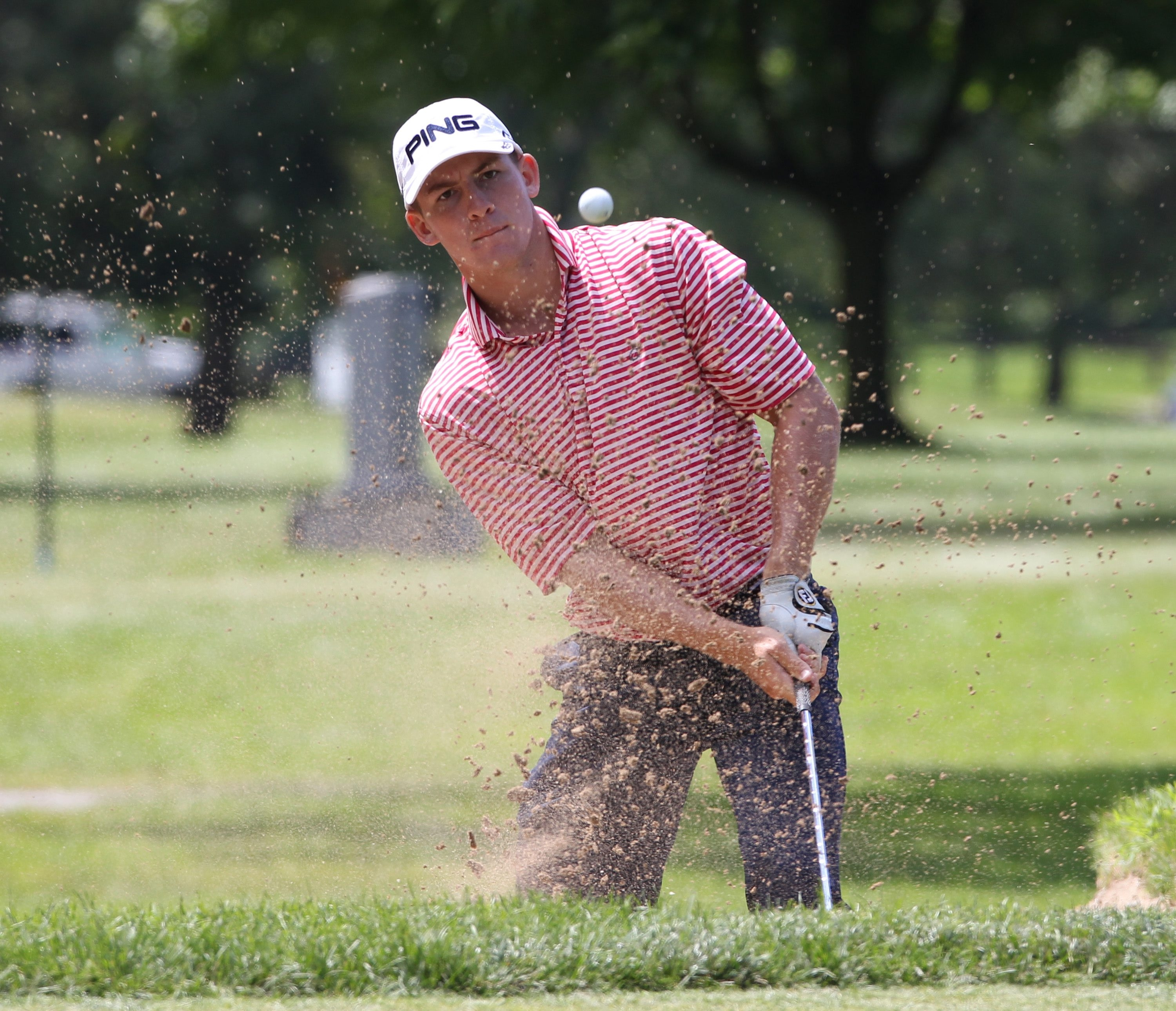 Tyler Dunlap hits out of the sand on the 11th hole en route to a birdie during the second round at Niagara Falls Country Club.