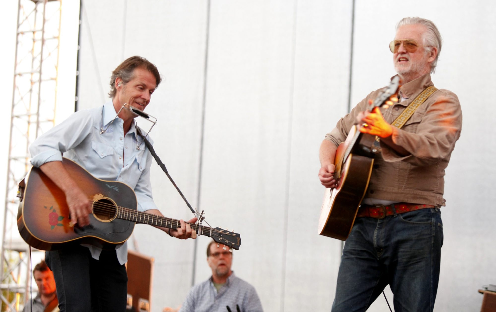 Blue Rodeo's Jim Cuddy, left, and Greg Keelor  perform with their group at Artpark  on Tuesday in a concert interrupted by a 15-minute downpour.