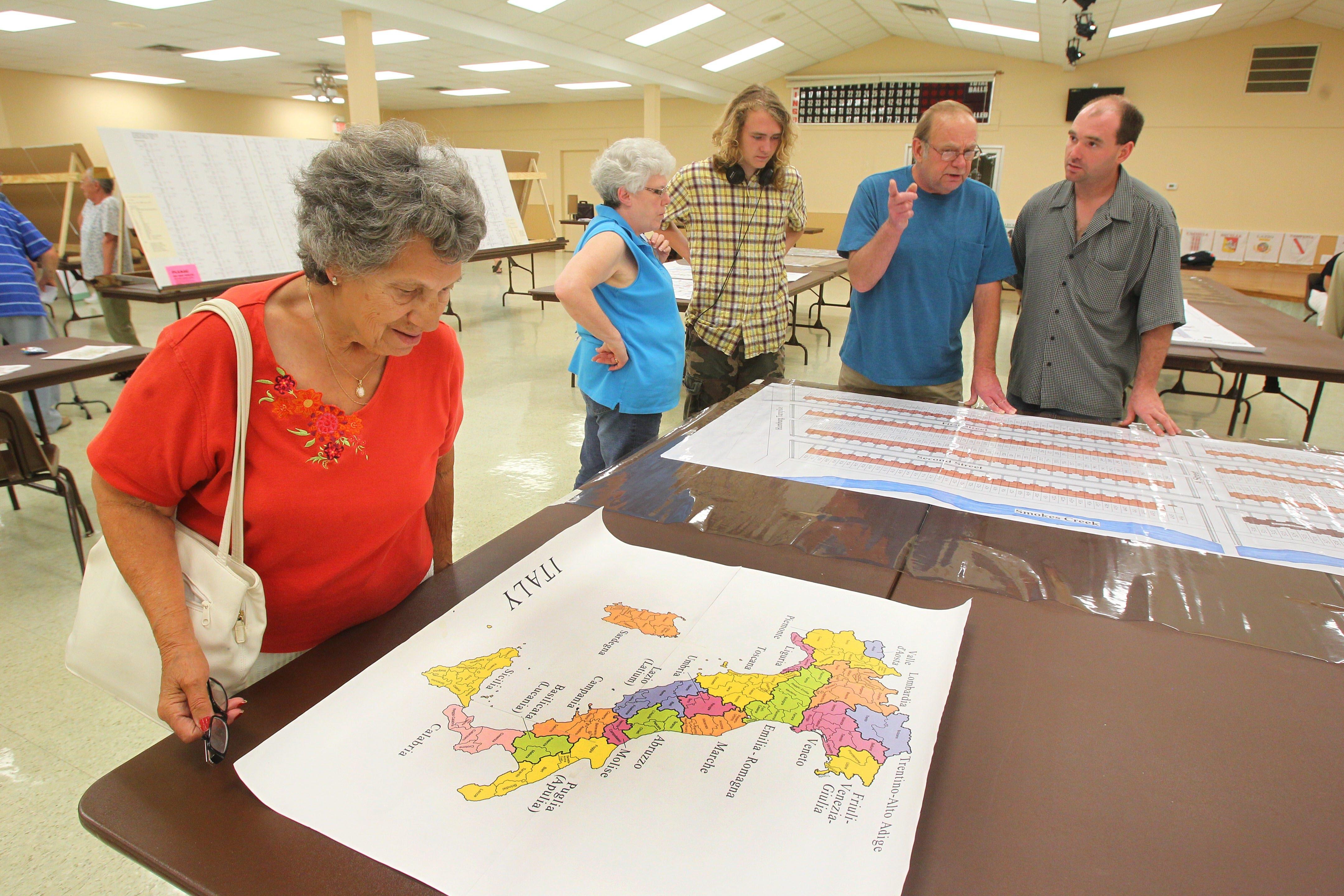 Mickey Andreozzi looks at a map of Italy on Saturday during the Lackawanna Italian Heritage Celebration.
