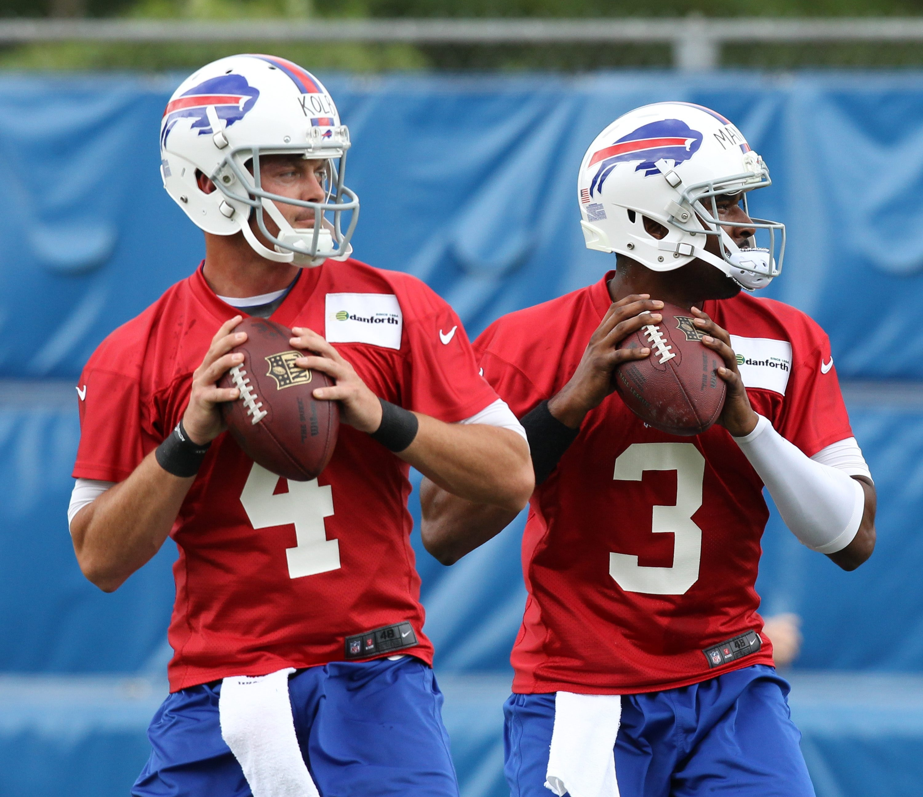 First-round draft choice EJ Manuel, right, will compete for the Bills' starting job with veteran Kevin Kolb.