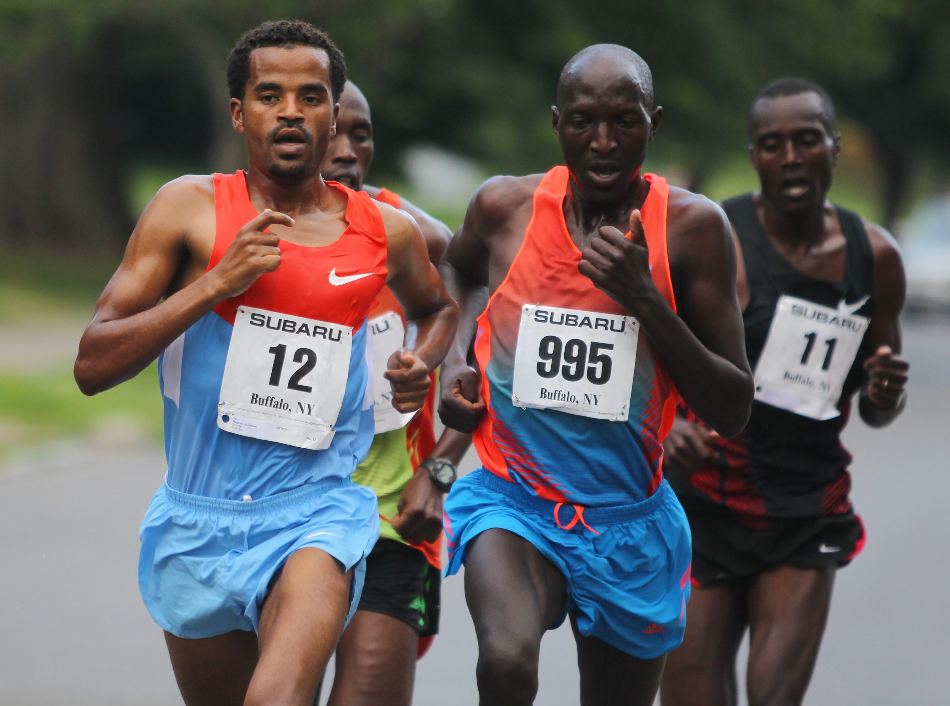 Aschalew Neguse (12), who is from Ethiopia, leads the pack on the way to victory in the Subaru 4-Mile Chase on Friday.