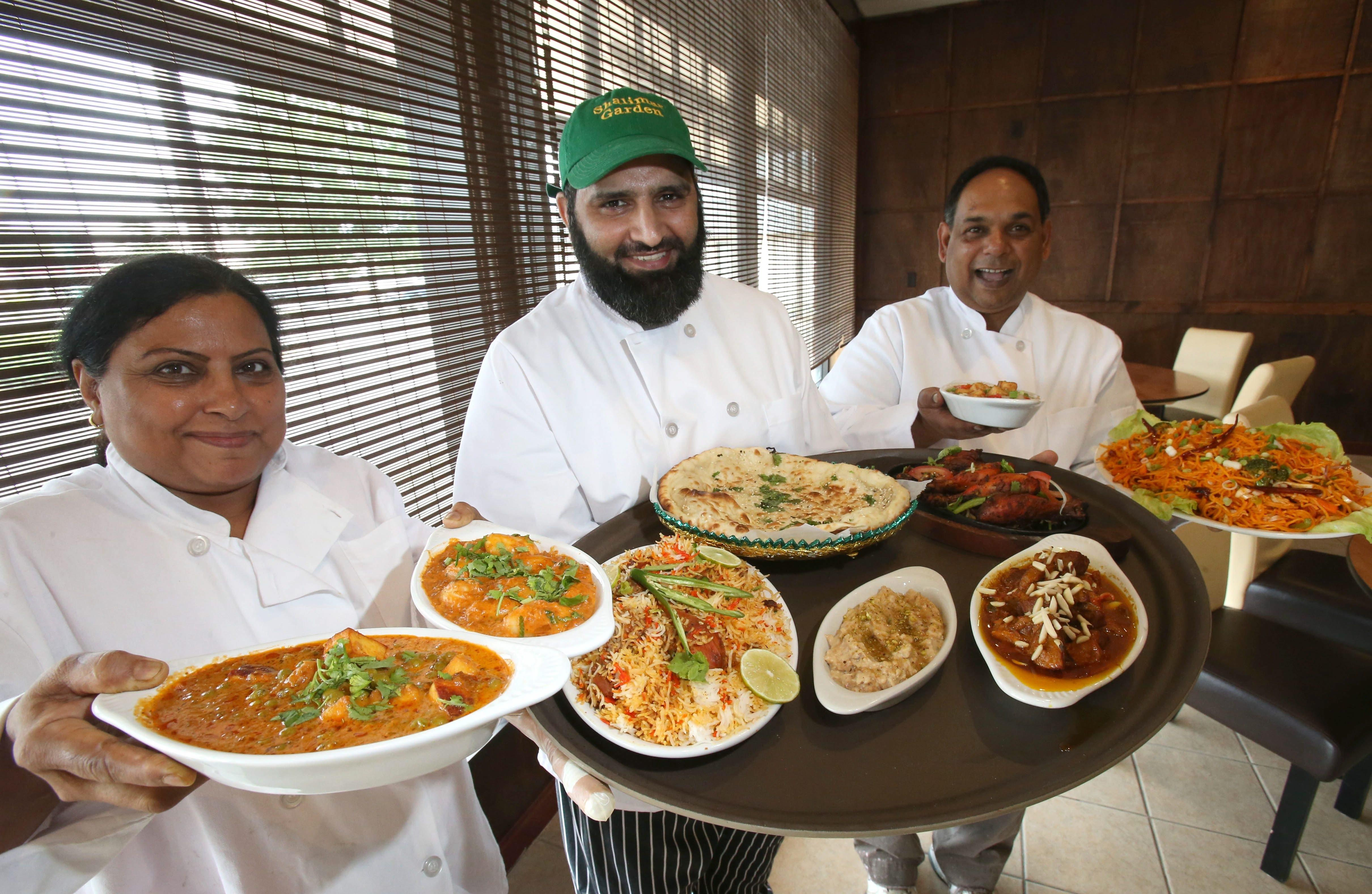 Robert Kirkham/Buffalo News  Specialty chefs display Hakka Chinese and Kashmiri dishes from Shalimar Garden. From left are chefs Poonam Matta, Abdul Shakoor and Robin Gabrail.