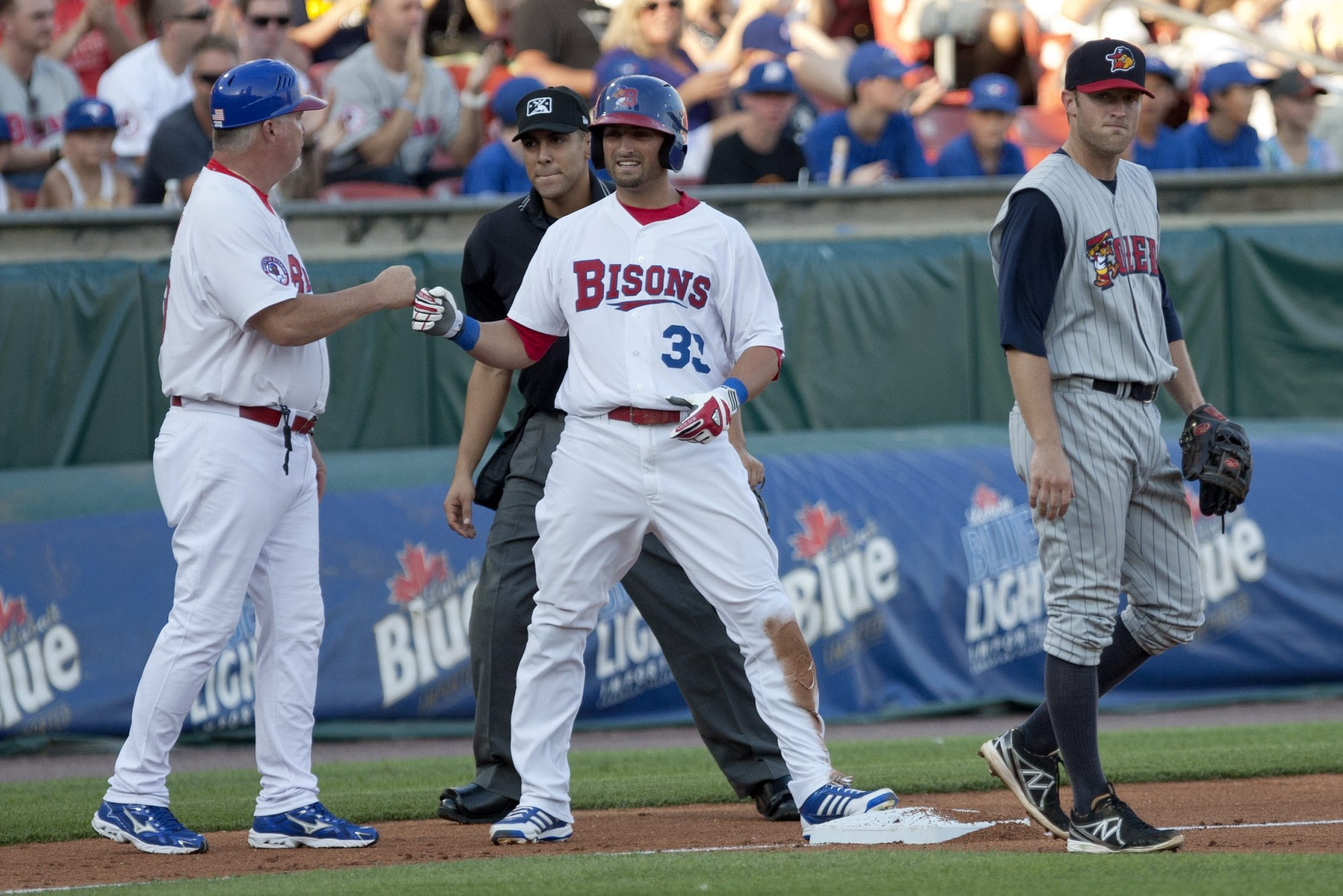 Kevin Pillar is congratulated by Bisons manager Marty Brown after hitting a triple against Toledo on Thursday.